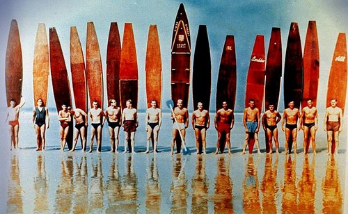 South African Beachguards and local surfers line up at St Ouen for a paddleboard race in the 1950's. Photo: John Houlebecq.